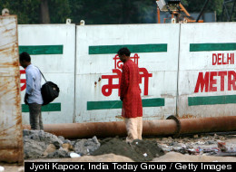 NEW DELHI, INDIA - SEPTEMBER 29: Delhites urinate in public right next to a sign board warning violators of a penalty in New Delhi on Tuesday, September 29, 2009. (Photo by Jyoti Kapoor/India Today Group/Getty Images)